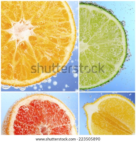 Collage of fruit in water with bubbles on blue background - stock photo