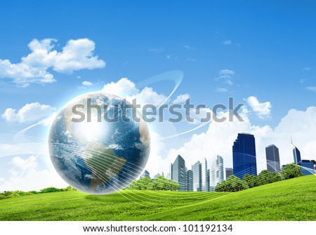 collage of green nature landscape with planet Earth above it - stock photo