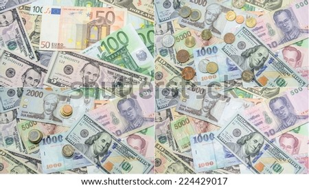 Collage of many different currency in coins and banknotes