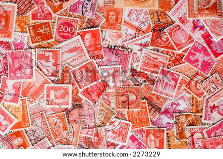 Collage of red used postage stamps. - stock photo