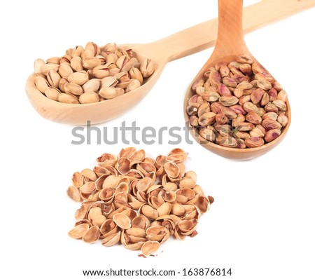 Collage of spoons with pistachios. Isolated on a white background. - stock photo