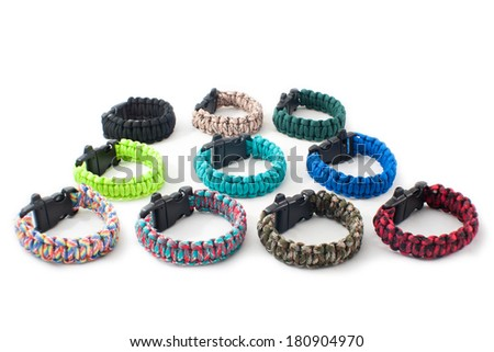 Collage of Survival Paracord Bracelets, isolated on white background - stock photo
