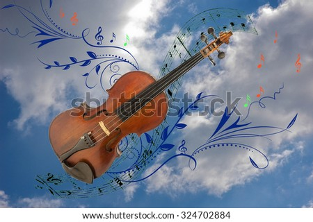 collage of violin, notes and vector graphics against the backdrop of the sky with white clouds - stock photo