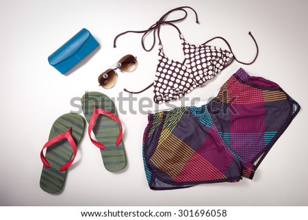 Collage of woman clothing and accessories isolated on white background - stock photo