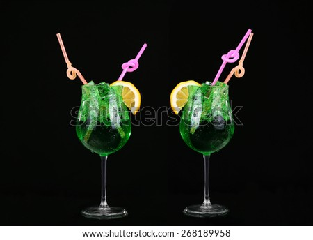collage Piggelin Drink, consisting of vodka, melon liqueur and lemon-lime soda. on black background - stock photo