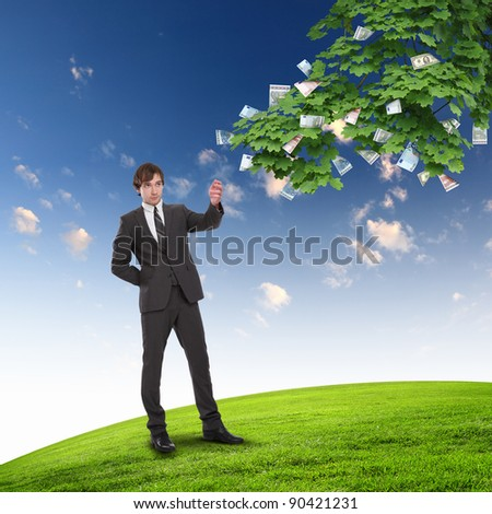Collage with a money tree and young business man - stock photo