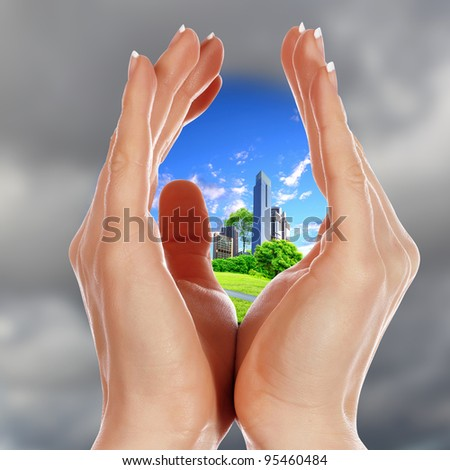 Collage with human hands and house against blue sky - stock photo