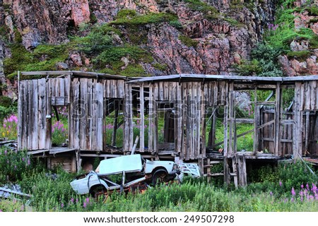 collapsed abandoned house within the Arctic circle - stock photo