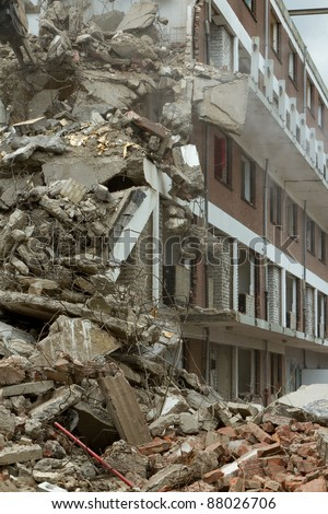 Collapsed block of flats - stock photo