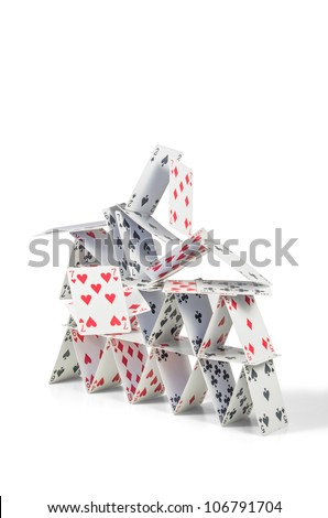 collapsing house of cards - stock photo