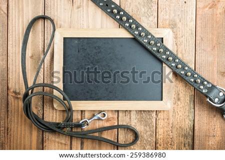Collar and lead and blackboard - stock photo