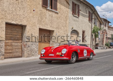 COLLE DI VAL D'ELSA, SI, ITALY - MAY 17: drivers P. Kolling S. Kolling on a vintage Porsche 356 1500 Speedster (1954) in historical rally Mille Miglia, on May 17, 2014 in Colle di Val d'Elsa SI Italy  - stock photo