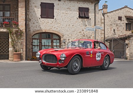 COLLE DI VAL D'ELSA, SI, ITALY - MAY 17: N. Khan - J. Breslow on a vintage car Ferrari 225 S Berlinetta Vignale (1952) in rally Mille Miglia, on May 17, 2014 in Colle di Val d'Elsa, Tuscany, Italy  - stock photo
