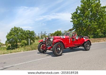COLLE DI VAL D'ELSA, SI, ITALY - MAY 17: the crew Amenduni - Vicari on a old racing car Alfa Romeo 6C 1500 MMS (1928) in race Mille Miglia on May 17, 2014 in Colle di Val d'Elsa, Tuscany, Italy  - stock photo