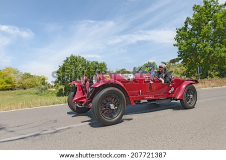 COLLE DI VAL D'ELSA, SI, ITALY - MAY 17: the crew Elicabe - Gessler on a racing car Alfa Romeo 6C 1500 GS Zagato (1933) in rally Mille Miglia, on May 17, 2014 in Colle Val d'Elsa, SI, Tuscany, Italy