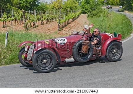 COLLE DI VAL D'ELSA, SI, ITALY - MAY 17: the crew Frans and Renee Van Haren on ancient racing car Alfa Romeo 8C 2900 A (1936) in rally Mille Miglia, on May 17, 2014 in Colle di Val d'Elsa, SI, Italy