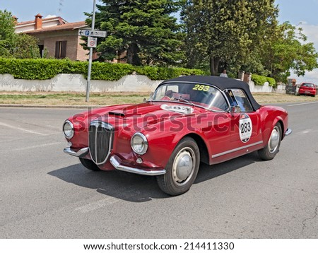 COLLE DI VAL D'ELSA, SI, ITALY - MAY 17: the crew Terlizzi Catasso on a vintage car Lancia Aurelia B24 Spider (1955) in rally Mille Miglia, on May 17, 2014 in Colle di Val d'Elsa, Tuscany, Italy  - stock photo