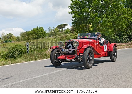 COLLE DI VAL D'ELSA, SI, ITALY - MAY 17: unidentified crew on a vintage sport car O.M. 665 SMM Superba (1930) in historical rally Mille Miglia, on May 17, 2014 in Colle di Val d'Elsa, Tuscany, Italy