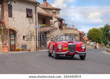 COLLE VAL D'ELSA, SI, ITALY - MAY 17: crew E. Thevenet P. Thevenet on a vintage Lancia Aurelia B24 Spider America (1955) in classic car race Mille Miglia, on May 17, 2014 in Colle Val d'Elsa SI Italy  - stock photo
