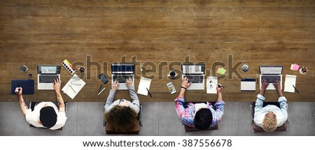 Colleagues Busy Working Laptop Office Concept - stock photo