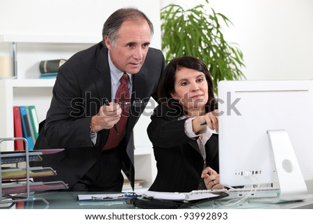 Colleagues discussing a project - stock photo
