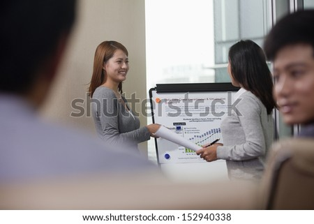 Colleagues Discussing Business Data - stock photo