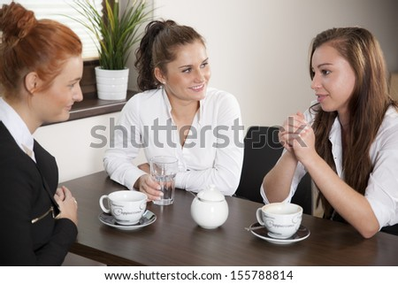 Colleagues drinking coffee during their office break
