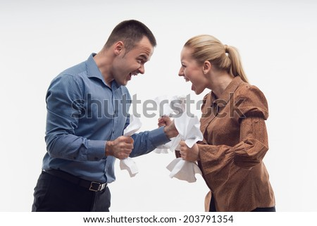 Colleagues fighting each other, shouting with paper in fists, waistup portrait isolated on white - stock photo