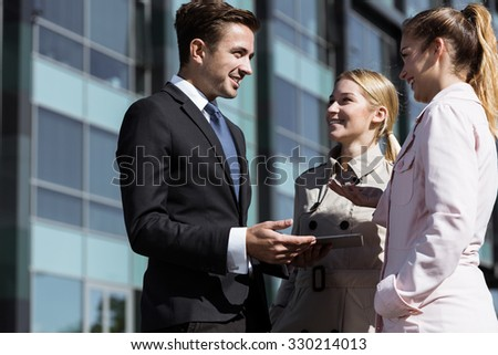 Colleagues having conversation during break at work