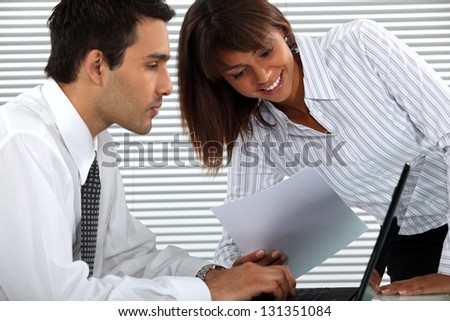 colleagues having fun at the office - stock photo