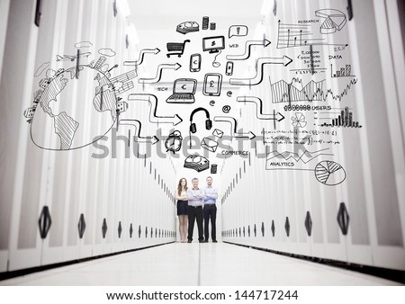 Colleagues in a data center standing in front of a drawing of a process - stock photo