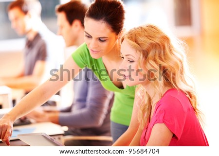 Colleagues in office working with tablet - stock photo