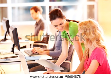 Colleagues in office working with tablet