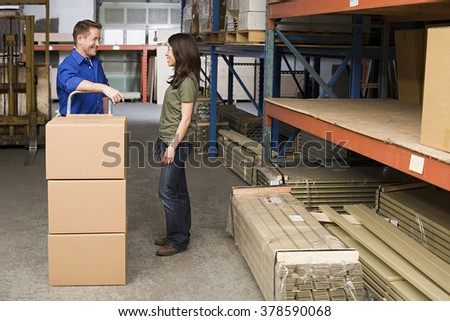 Colleagues in warehouse - stock photo