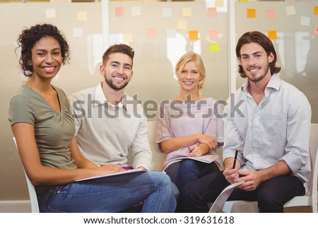 Colleagues interacting with each other at a meeting - stock photo