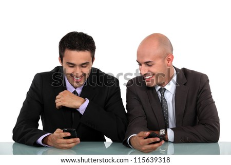 Colleagues laughing together - stock photo