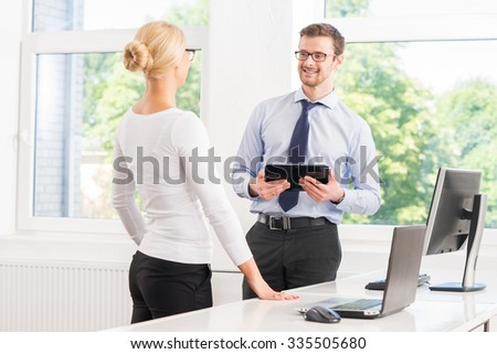 Colleagues working in the office with a tablet.