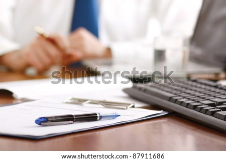 Colleagues working together in office. - stock photo