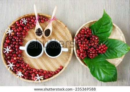 Collect of cafe, red ripe berries, roasted coffee bean, cup of black coffee, green leaf, white flower on bamboo basket,  amazing decor, harmony design for advertise - stock photo