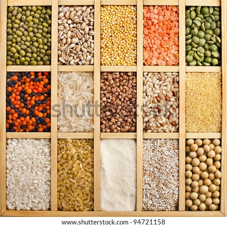 collection assorted of lentils, beans, peas,  grain ,groats, soybeans, legumes in wooden box  close up macro top view  backdrop