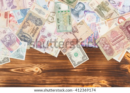 Collection from different money bills on the wooden background
