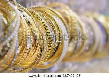 Collection gold bracelets trimmed with pearls - stock photo