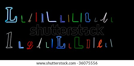 collection of a number of different neon letter L isolated on black - part of a series of neon letters - stock photo