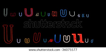 collection of a number of different neon letter U isolated on black - part of a series of neon letters
