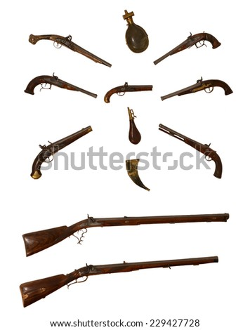 Collection of antique firearms isolated on white background - stock photo