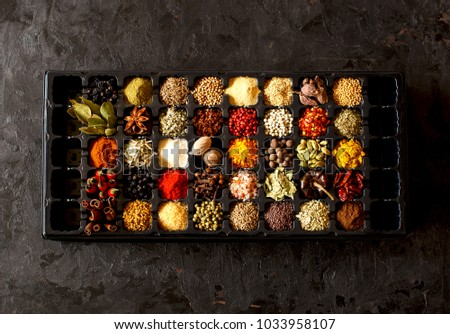 Collection of aromatic colorful spices on blak background.