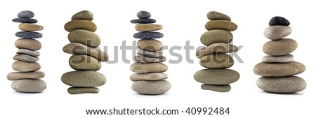Collection of Balanced stone stacks or towers isolated over white. Full-size images are in my portfolio