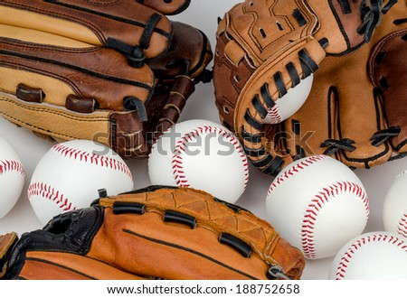 Collection of Baseball Gloves and Baseballs - stock photo