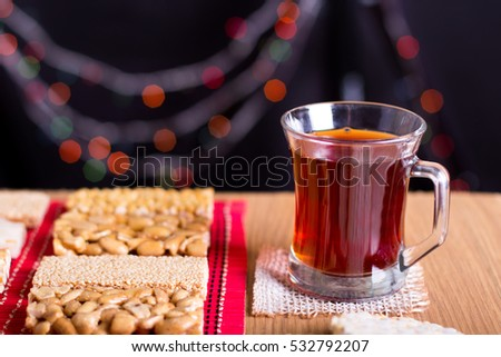 Collection of Beans Candies and Sweets ( Mawlid Halawa ) with Cup of Red Tea - Egyptian Culture Dessert usually Eaten During Prophet Muhammad Birth Celebration