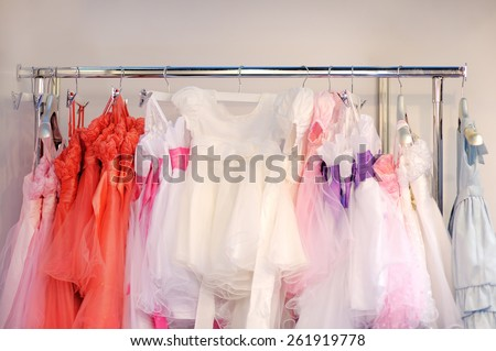 Collection of beautiful children dresses for little bridesmaids - stock photo